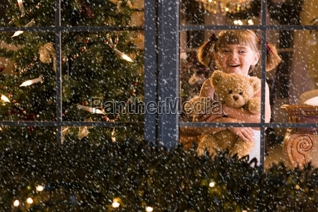 little girl looking at snow