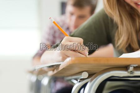 hand skrivebord uddannelse makrooptagelse naerbillede kvindelig