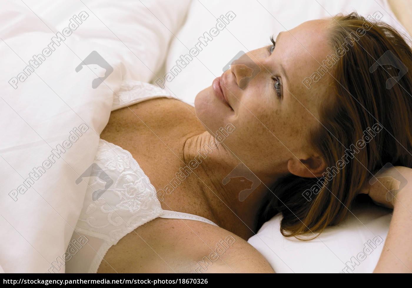 girl, lying, in, bed - 18670326