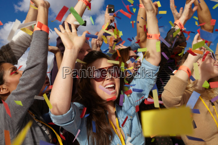people cheering at a music festival