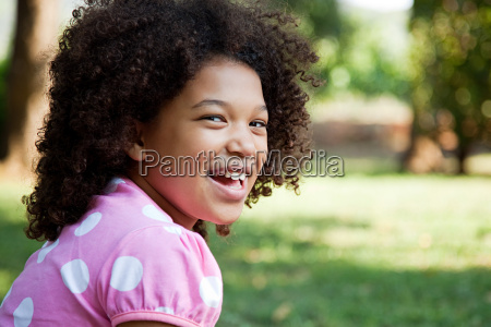 young girl wearing pink spotty top