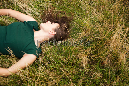 young woman lying down in a
