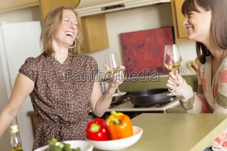 mid adult female friends drinking wine