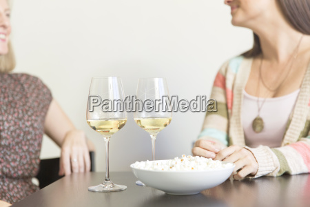 mid adult female friends drinking at