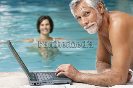 man and woman in swimming pool
