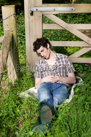 young man asleep in countryside