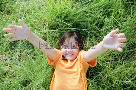 smiling girl lying on grass