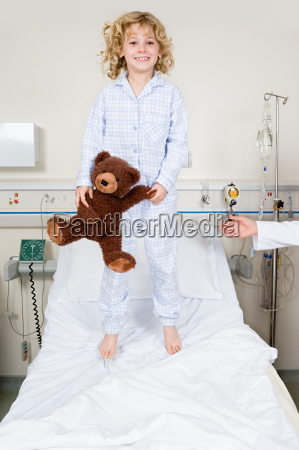 girl jumping on hospital bed