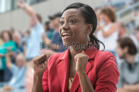 excited woman in crowd