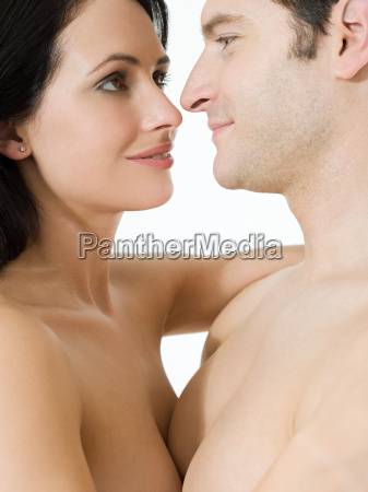 nude couple face to face