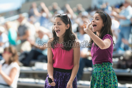 two excited girls at a pop