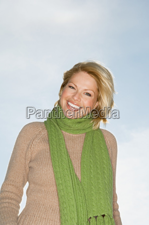 blond woman wearing green scarf