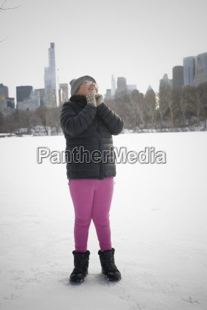 young girl standing in snowy landscape