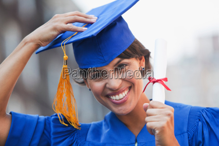 portrait of mid adult woman graduating
