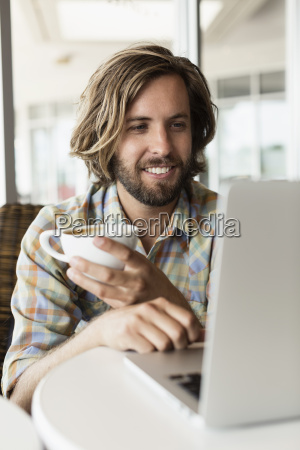 mid adult man in coffee shop