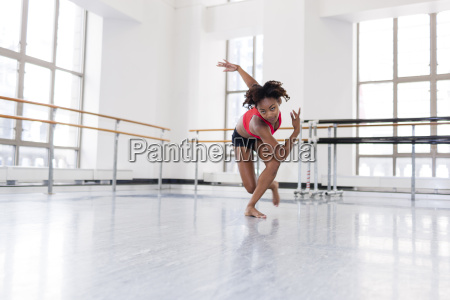 young woman in dance studio dancing