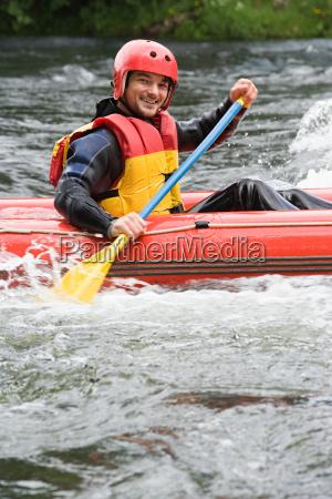man white water rafting