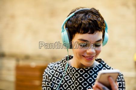 mid adult woman wearing headphones looking