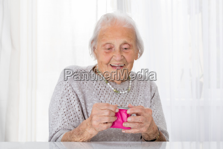 senior woman holding small purse