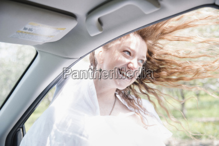 woman on a road trip leaning