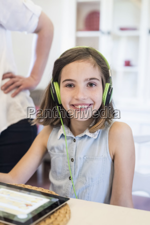 portrait of smiling girl with digital
