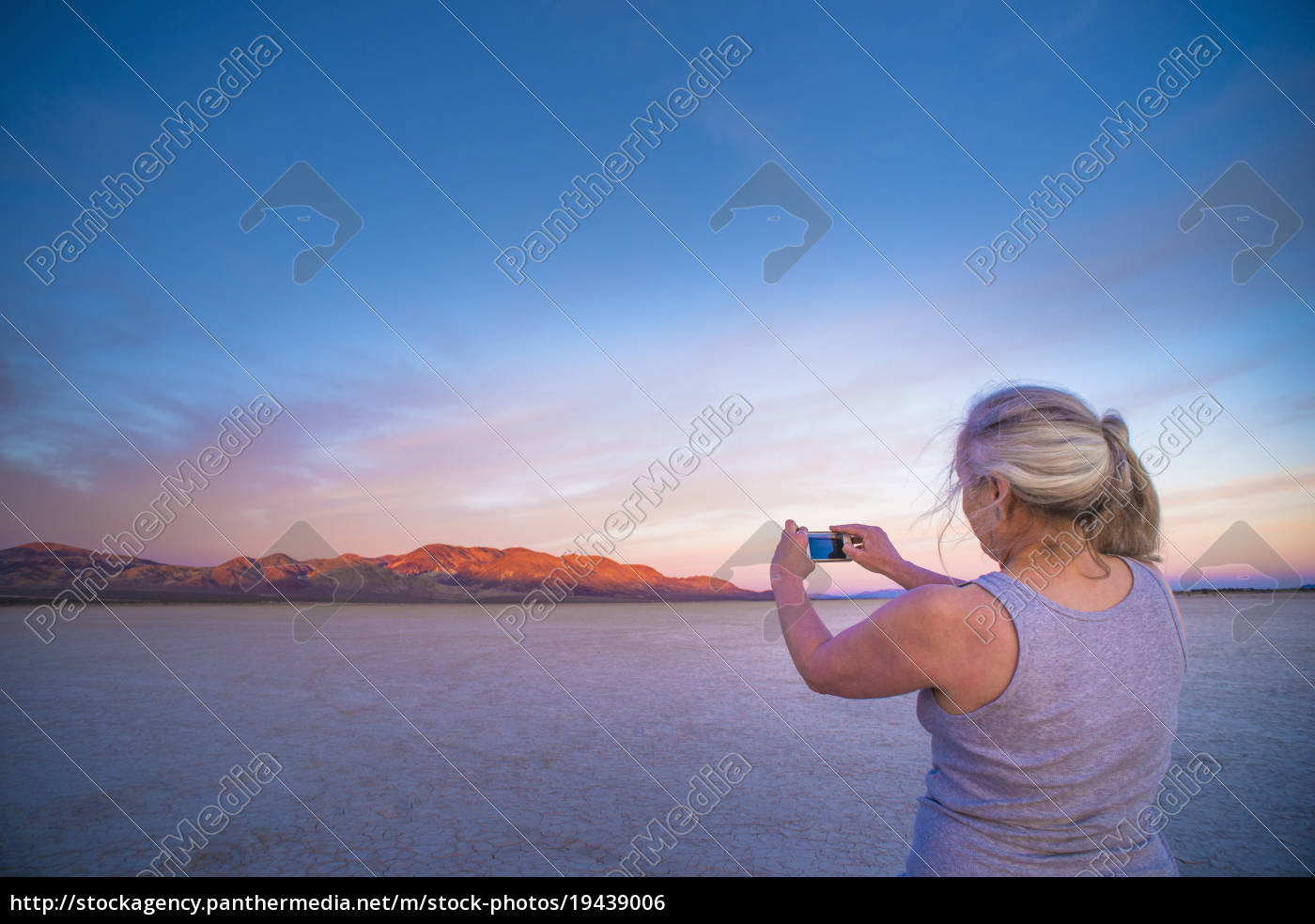 woman, taking, smartphone, photograph, of, salt - 19439006