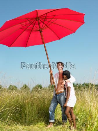 couple with a beach umbrella in