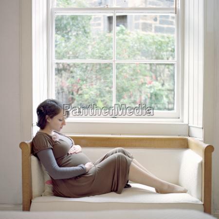 portrait of mid adult pregnant woman