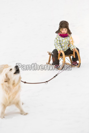 girl being pulled by dog on