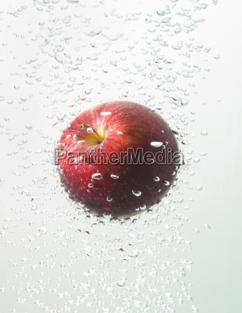 apple in water bubbles