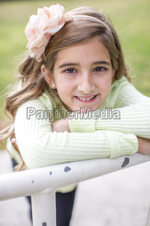 portrait of girl leaning on railing