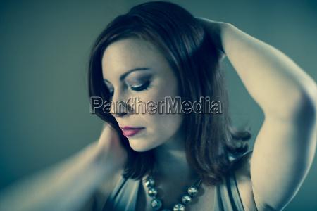 portrait of mid adult woman posing
