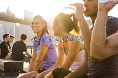 four young adult running friends chatting