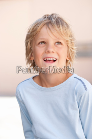 close up of boys smiling face