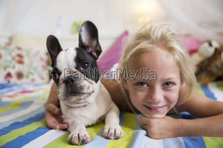 portrait of girl and cute dog