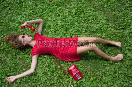 teenage girl lying on grass with