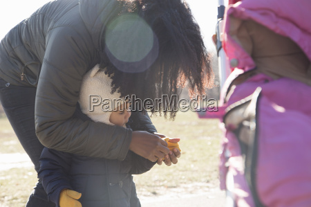mid adult woman putting gloves on