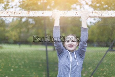 young woman arms raised holding goal