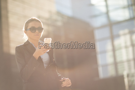 young city businesswoman reading smartphone text