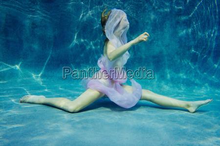 woman draped in fabric swimming semi