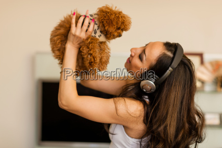 mid adult woman wearing headphones and