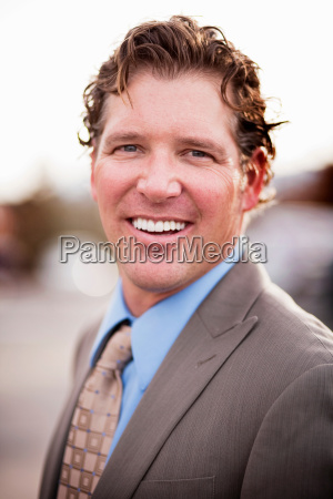 portrait of smiling man in suit