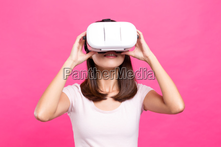 woman watching virtual reality equipment