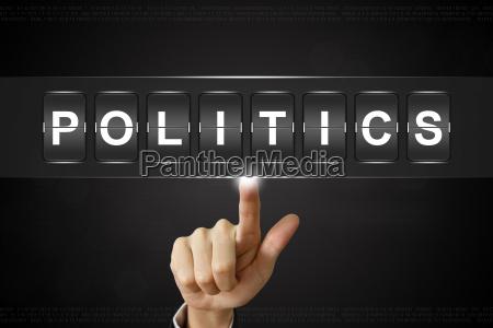 business hand klikker politik pa flipboard