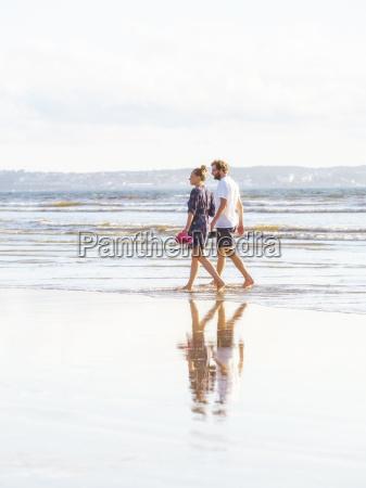 couple talking a beach walk