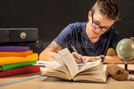 student doing homework in dark room