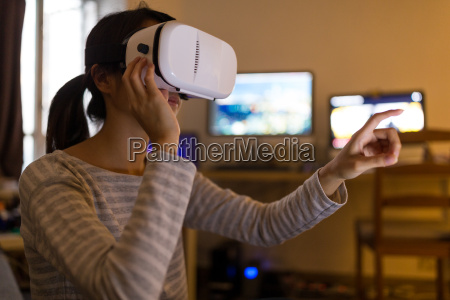 woman looking though with virtual reality