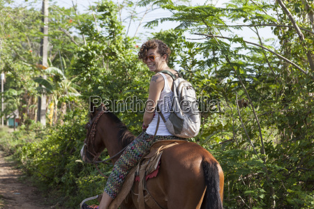 girl riding a horse in vinales