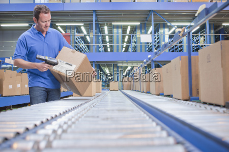 worker using scanner in warehouse despatch