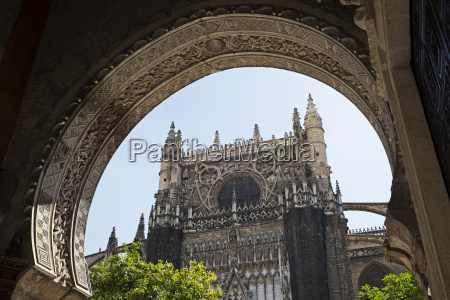 seville cathedral through arch seville andalucia